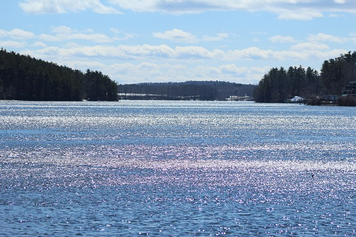 The Merrimack River sparkles on a sunny, cloudy, windy afternoon